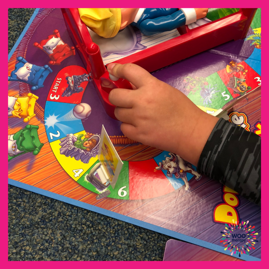 Child using a pointer finger to press down a game piece
