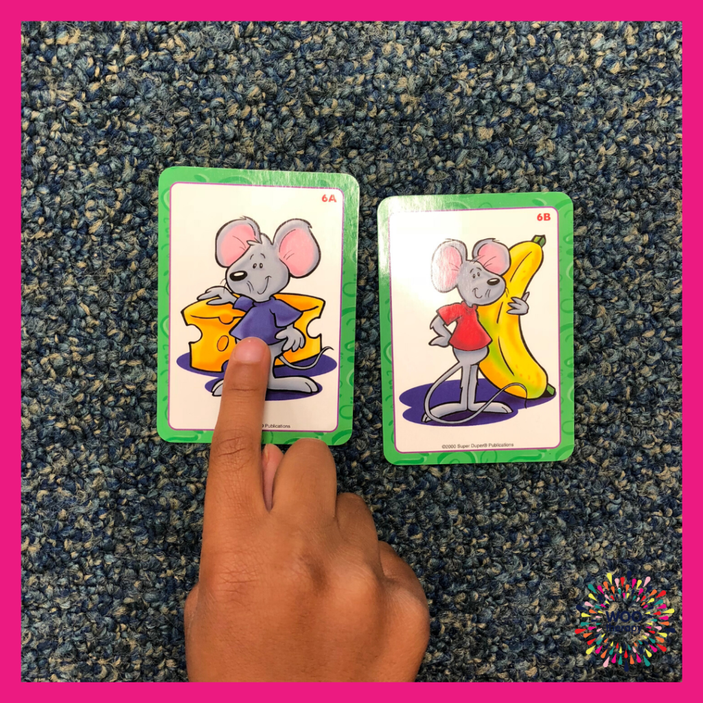 Child using a pointer finger to show the differences between two images.