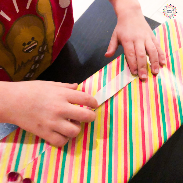 Visuo-spatial skills required to accurately place tape to secure flap during gift wrapping.