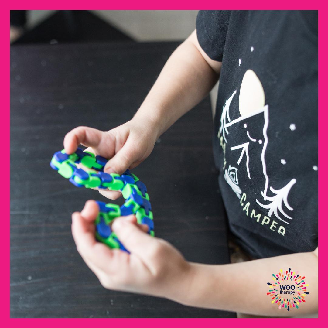 Child using fine motor skills to twist, straighten, and manipulate this fidget toy.