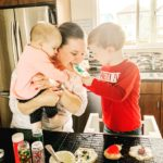 A mom baking holiday cookies with her kids.