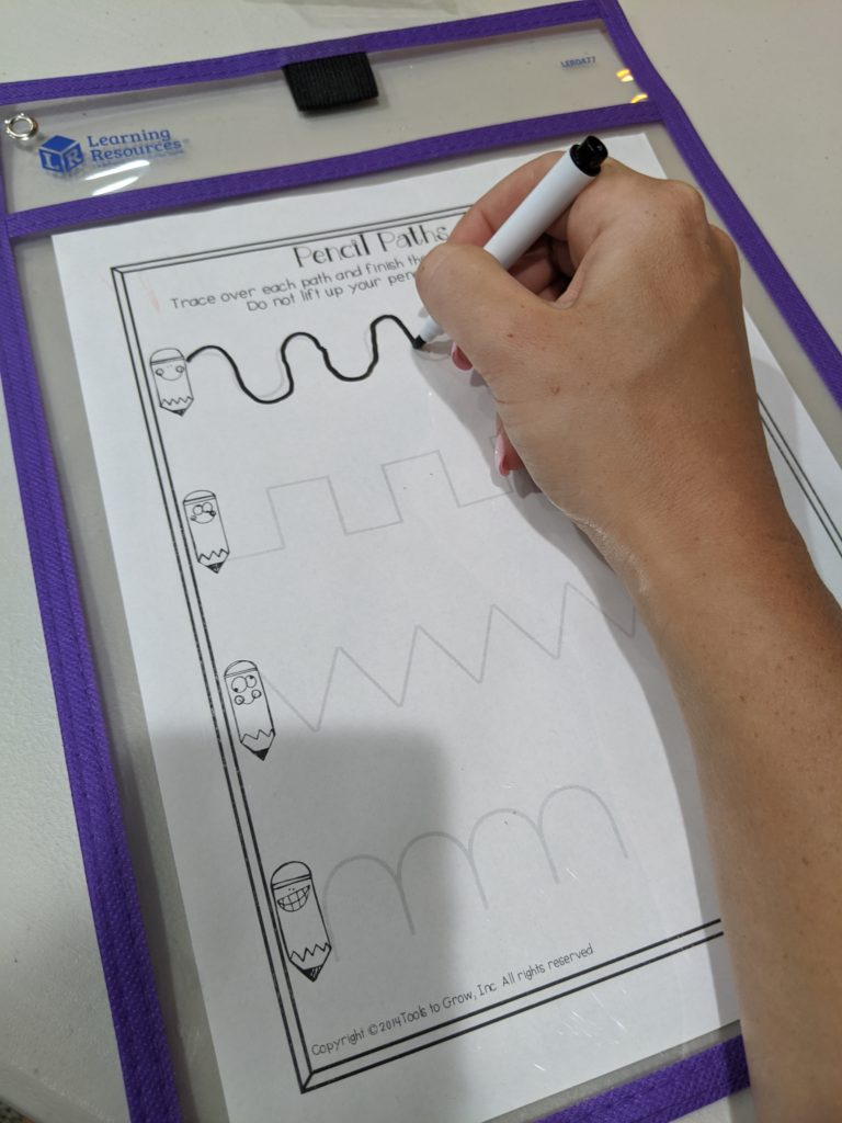 Using a clear pocket and dry erase marker to work on pre-writing lines.