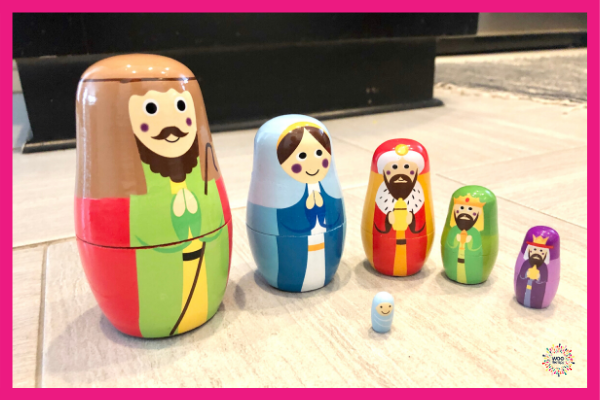 Playing with Wooden Nativity Nesting Dolls.