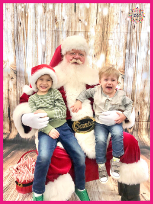 Classic Santa picture...one kid loving it, the other one screaming his head off.