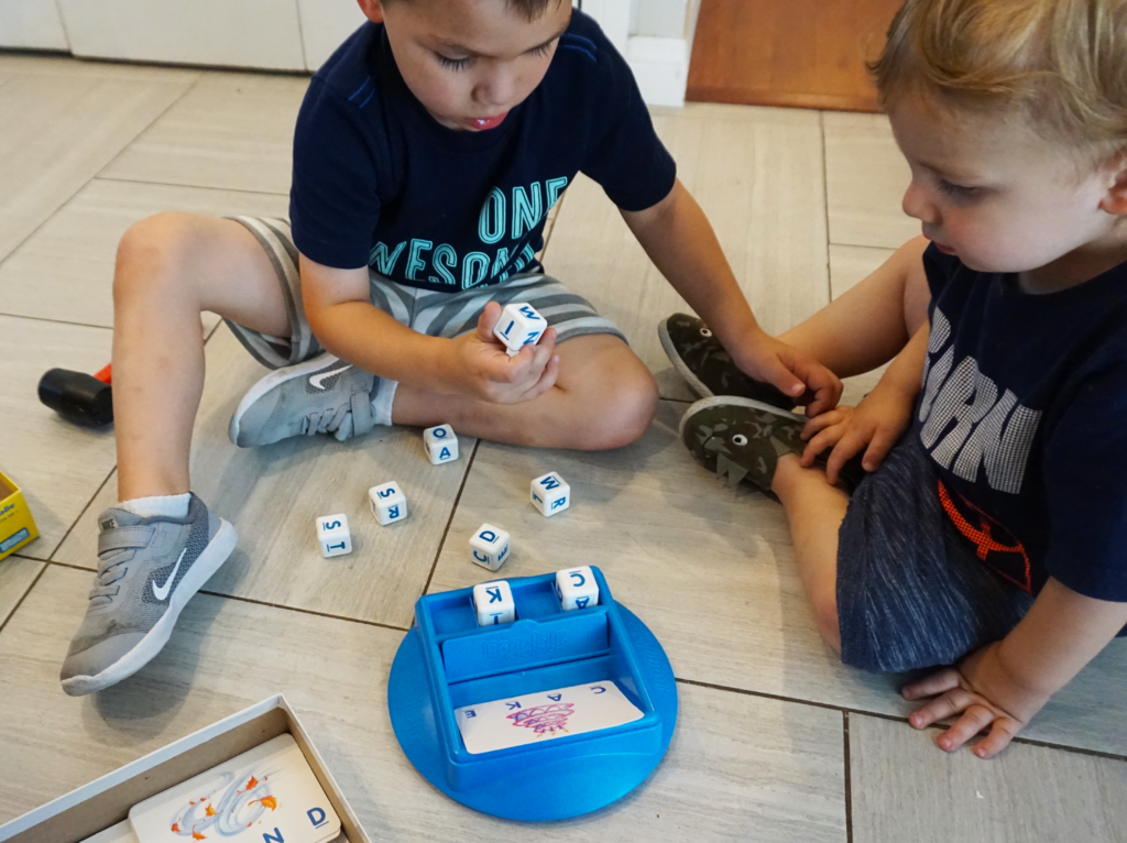 Using fine motor, visual perceptual, and pre-reading skills to match the letters for this fun dice game of Boggle Jr.