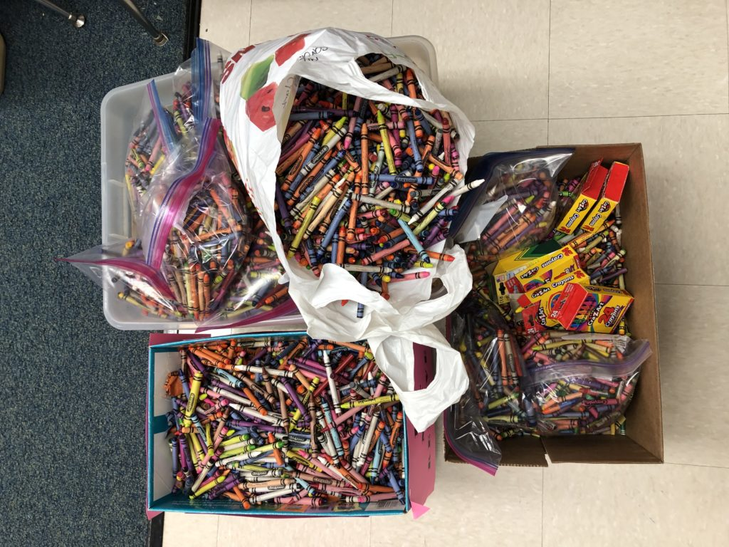 Boxes full of donated crayons that still have lots of life through one of these 7 ways to make old crayons new by WooTherapy