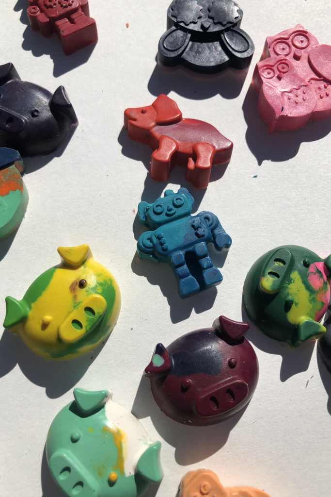 Crayons melted into sure shapes of dinosaurs, pigs, owls, robots