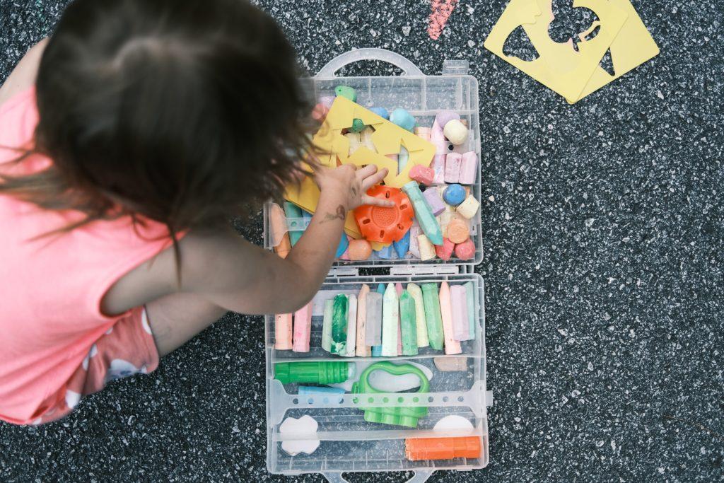 Using chalk for fine and gross motor development.